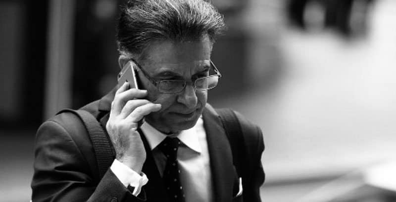 criminal lawyer Manny Conditsis on the phone