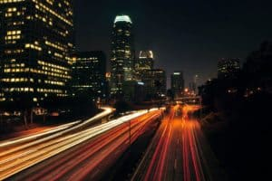 city lights and buildings with traffic lights speed up